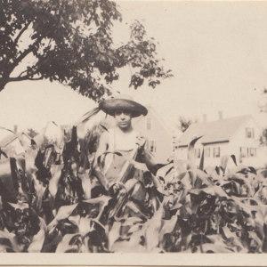 Boy at work in corn field